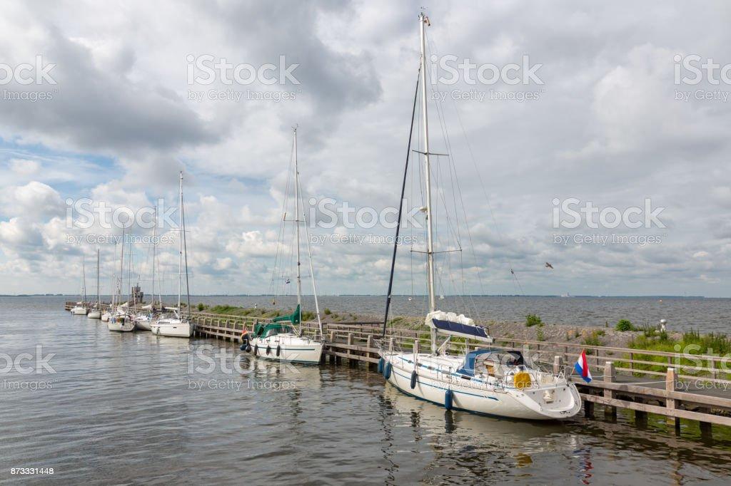 Harbor historic Dutch village Urk with modern sailing yachts stock photo