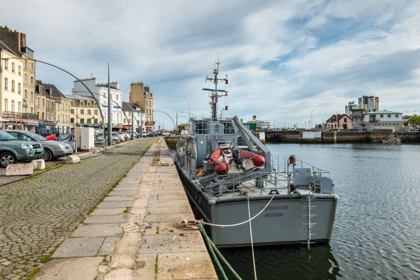 Harbor in Cherbourg-Octeville, Normandy, France Cherbourg-Octeville, France - May 22, 2017: Boat in the port of Cherbourg-Octeville, Normandy, France. Cherbourg harbour is the biggest artificial harbor in the world. cherbourg stock pictures, royalty-free photos & images
