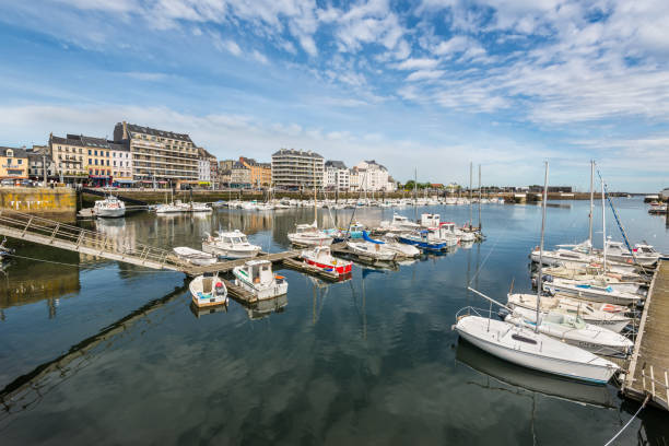 Harbor in Cherbourg-Octeville, Normandy, France Cherbourg, France - May 22, 2017: Boats in the port of Cherbourg-Octeville, on the north of the Cotentin peninsula, Cherbourg harbour is the biggest artificial harbor in the world. cherbourg stock pictures, royalty-free photos & images