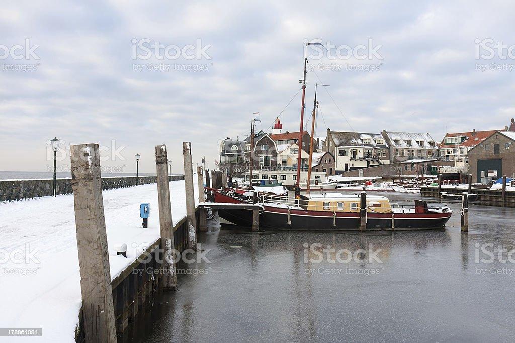 Harbor of Dutch fishery village Urk in wintertime stock photo