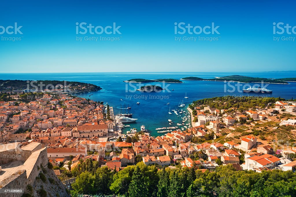 Harbor of old Adriatic island town Hvar. High angle panorama. stock photo