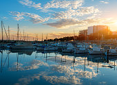 Harbor of Palma de Mallorca in sunset with cloud mirroring