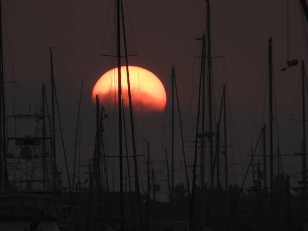 Harbor sunset on the Gulf stock photo