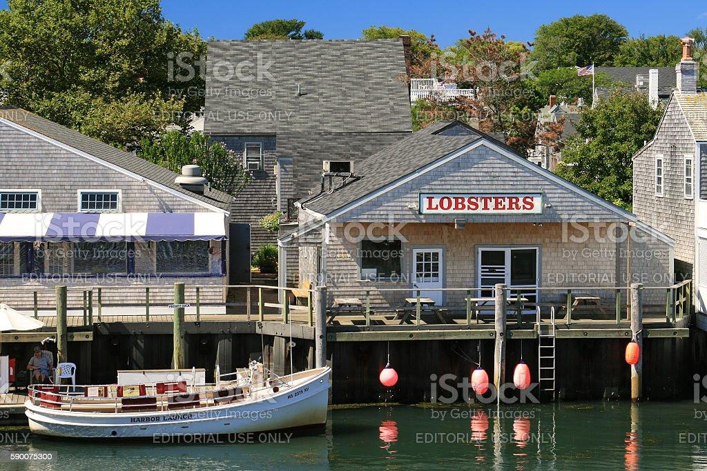Harbor View, Lobster Restaraunt and Moored Boat, Nantucket Island, Massachusetts. stock photo