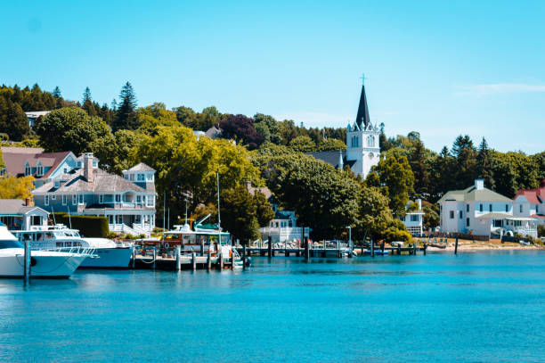 harbor view of mackinac island from lake huron - mackinac island stock photos and pictures