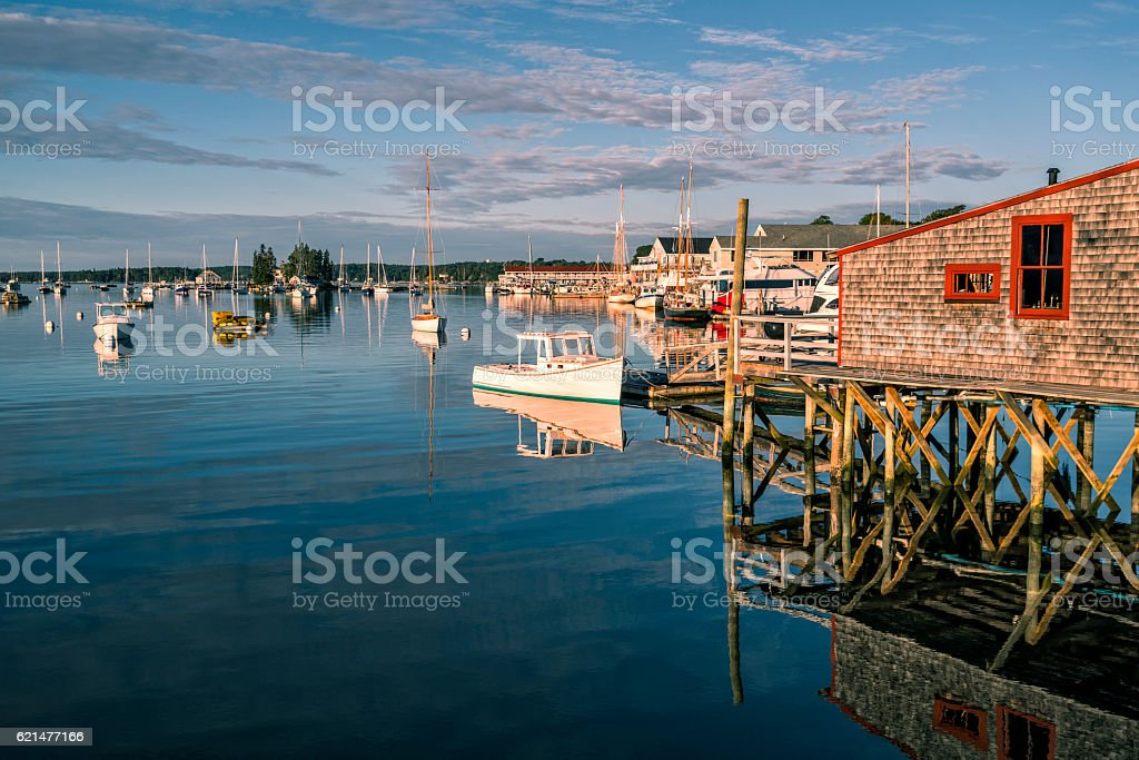 Harbor with rustic fishing pier in Maine stock photo