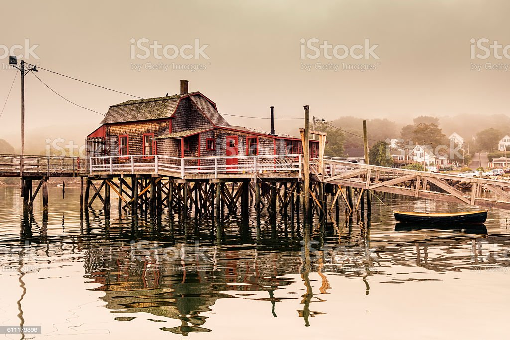 Harbor with rustic fishing shack in Maine stock photo
