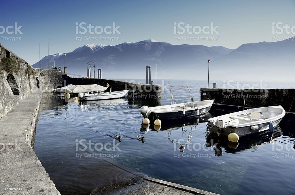 Harbor with snow-capped mountains stock photo