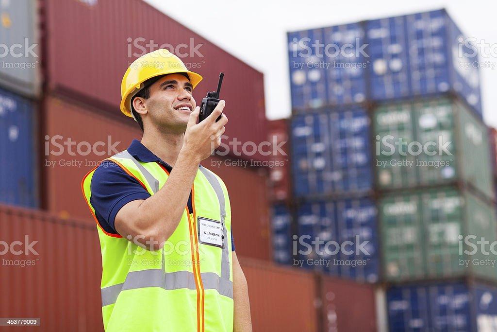 harbor worker talking on the walkie-talkie stock photo