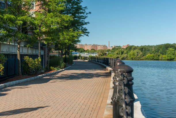 Harborwalk curving along Charles River in Waltham Harborwalk in Waltham curving along edge of Charles River massachusetts stock pictures, royalty-free photos & images