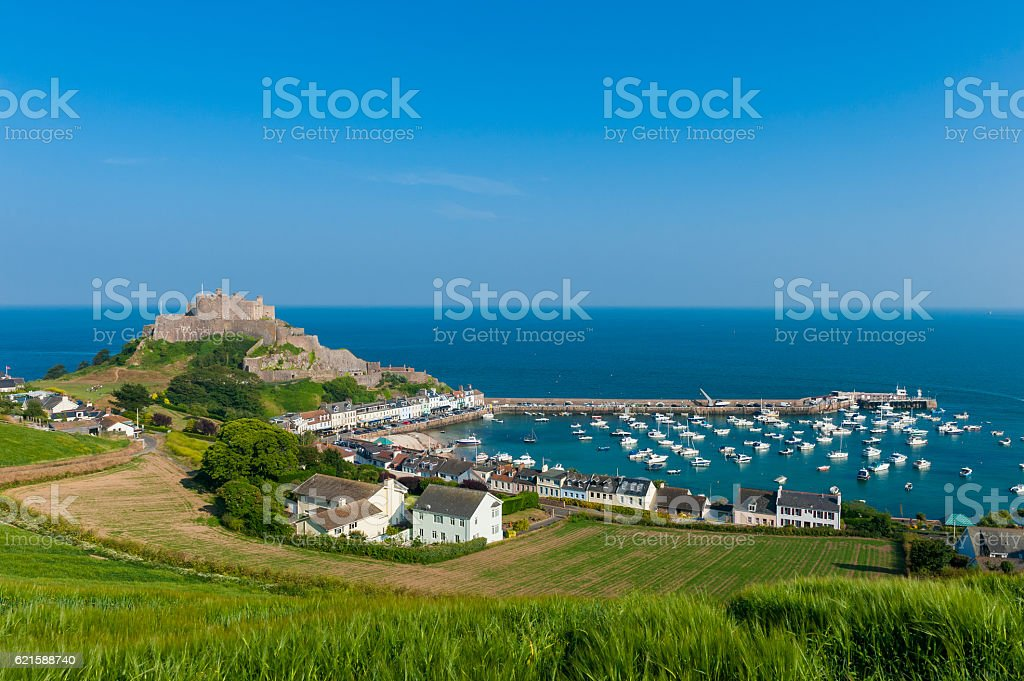 Harbour and Gorey Castle in Saint Martin Jersey stock photo
