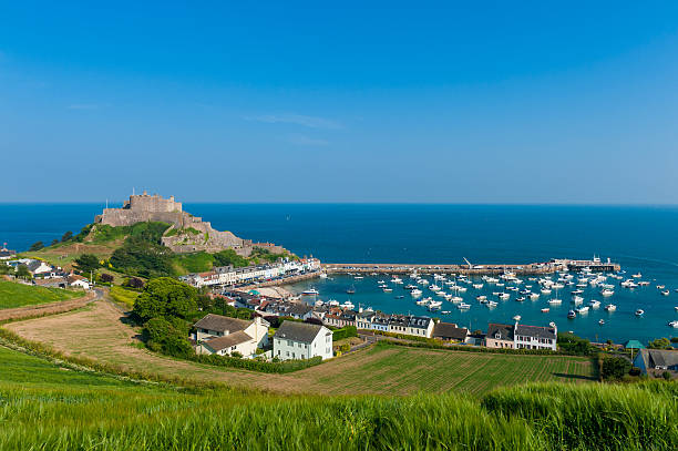 Harbour and Gorey Castle in Saint Martin Jersey Harbour and Gorey Castle in Saint Martin, Jersey, Channel Islands, UK on summer day. 2013 stock pictures, royalty-free photos & images