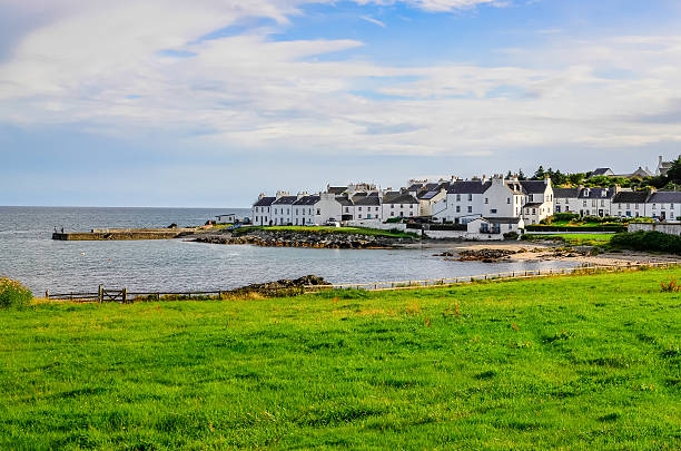 Harbour and town view Port Charlotte on Isle of Islay stock photo