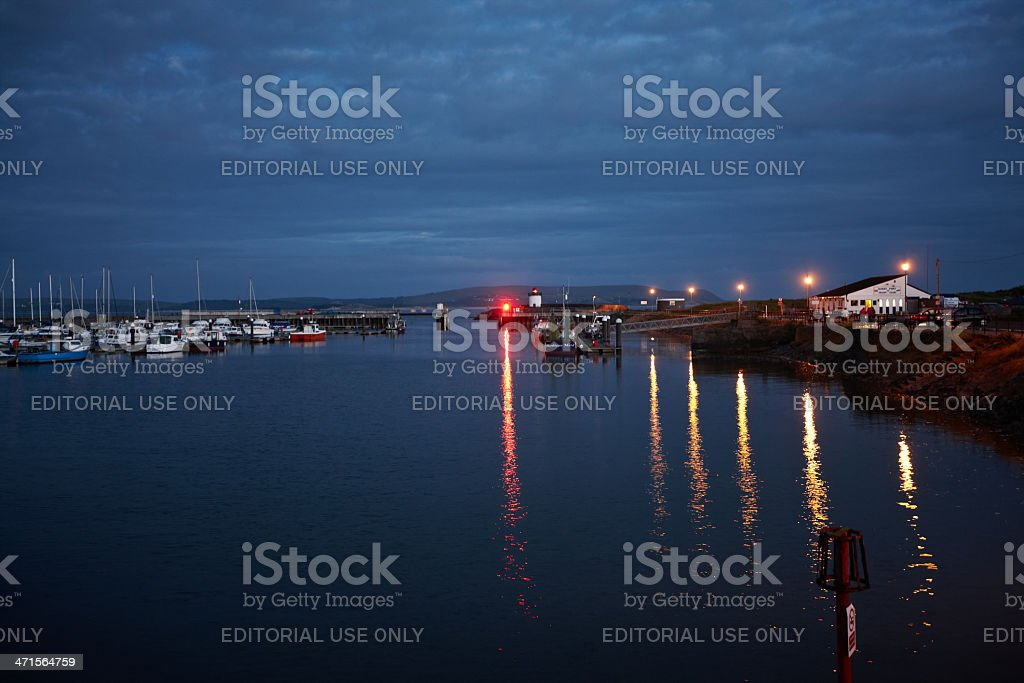 Harbour light reflections at dusk royalty-free stock photo
