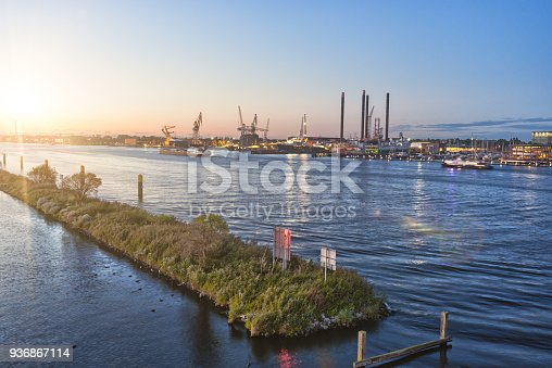 istock Harbour of Amsterdam, Europe, at dusk 936867114