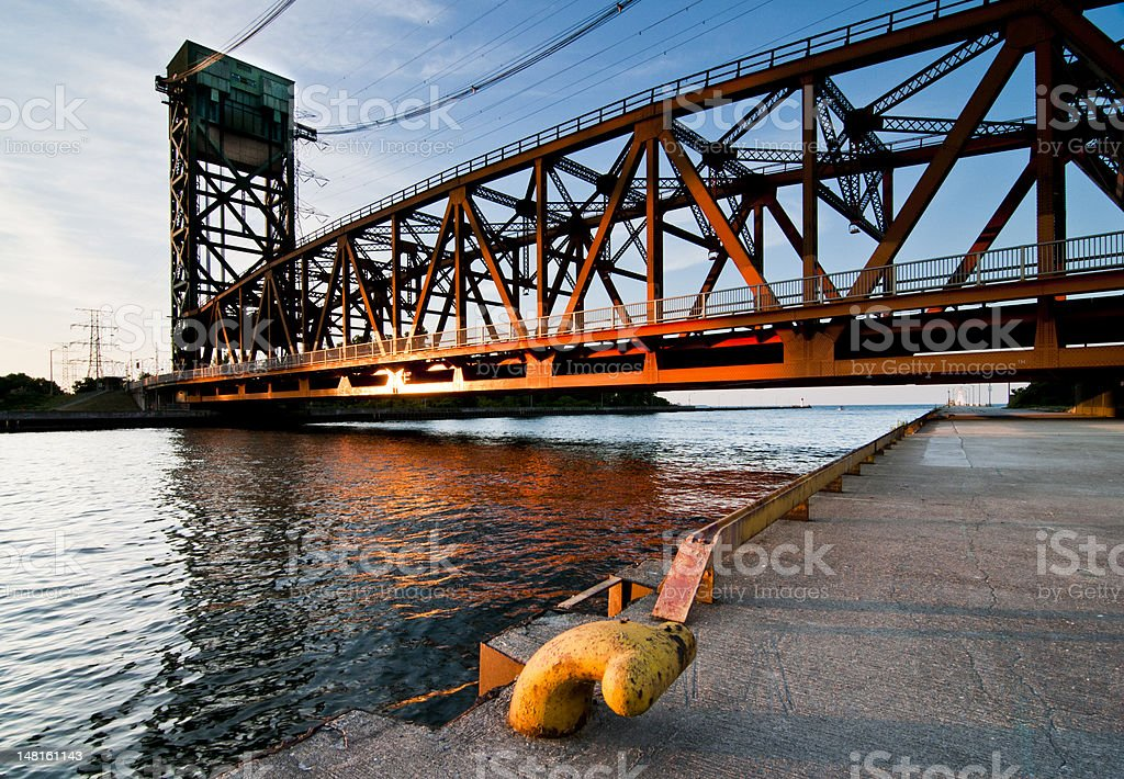 harbour with lift bridge in sunset stock photo