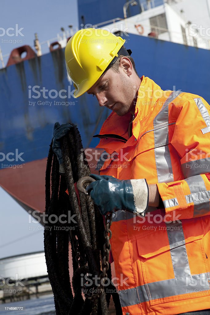 harbourworker by oiltanker royalty-free stock photo