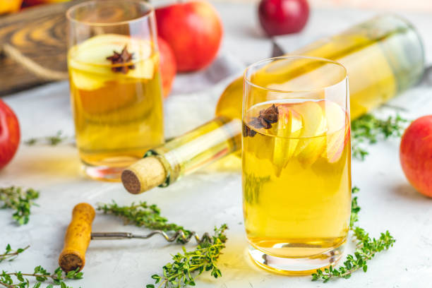 Hard apple cider cocktail with fall fresh thyme and star anise stock photo