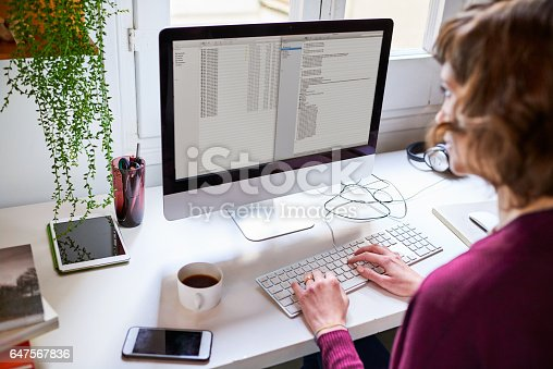 istock Hard at work on her computer 647567836