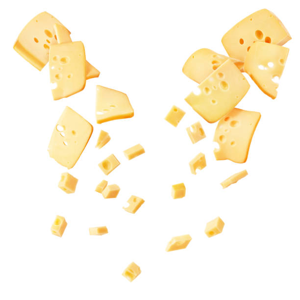 Hard cheese cut into strips and cubes isolated on a white background stock photo