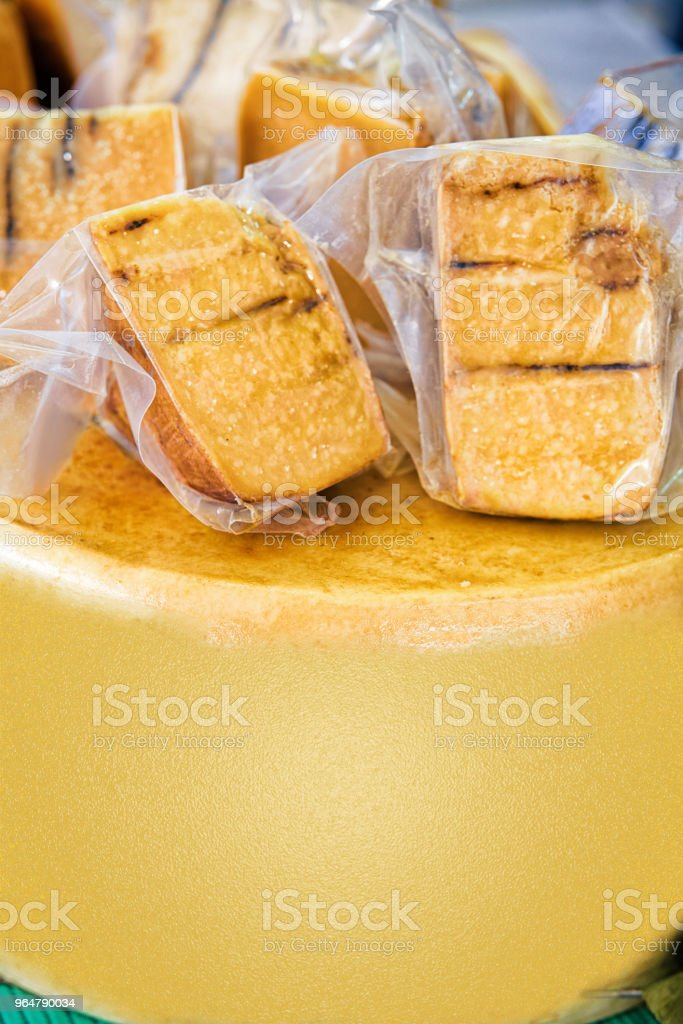 Hard cheese display street market Bled Lake Slovenia royalty-free stock photo