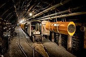 Hard coal mine underground corridor with steel support system and electrical equipment, Bochum, Germany