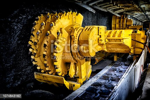 Hard coal mine underground corridor with support system and drilling machine, Bochum, Germany