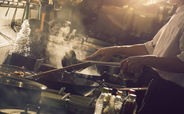 Hard cooking with chef stock photo