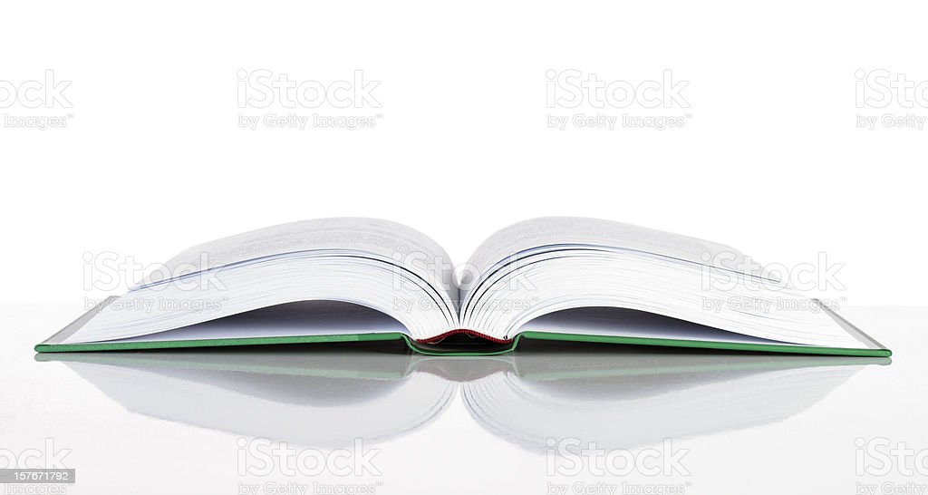 A hard cover book laid open on a white surface stock photo