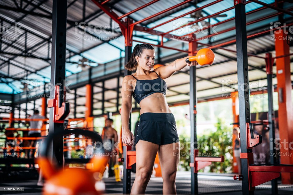 Hard Cross Training With Kettlebells For Women Stock Photo - Download Image  Now - iStock