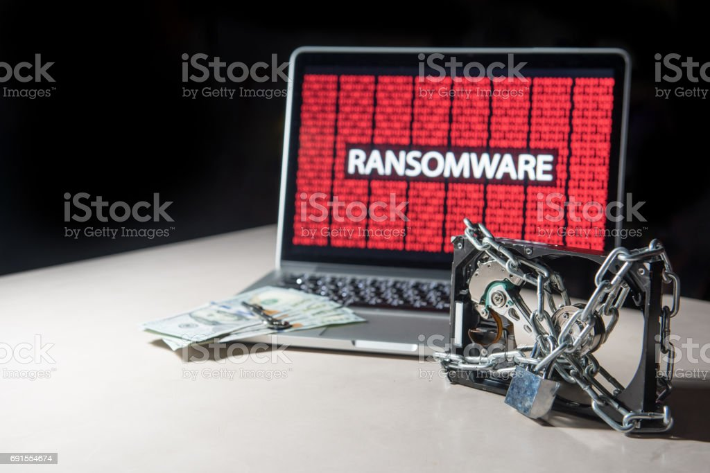 Hard disk file locked with monitor show ransomware cyber attack stock photo