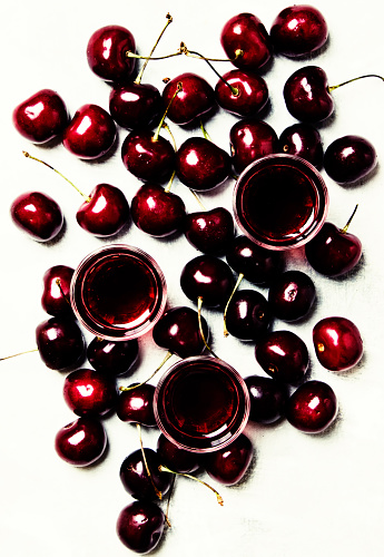 istock Hard drink with fresh cherries, top view 823736458