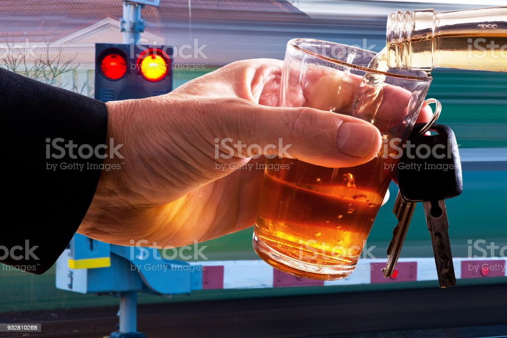 Hard Drinker with Glass of Spirits and Car Key stock photo