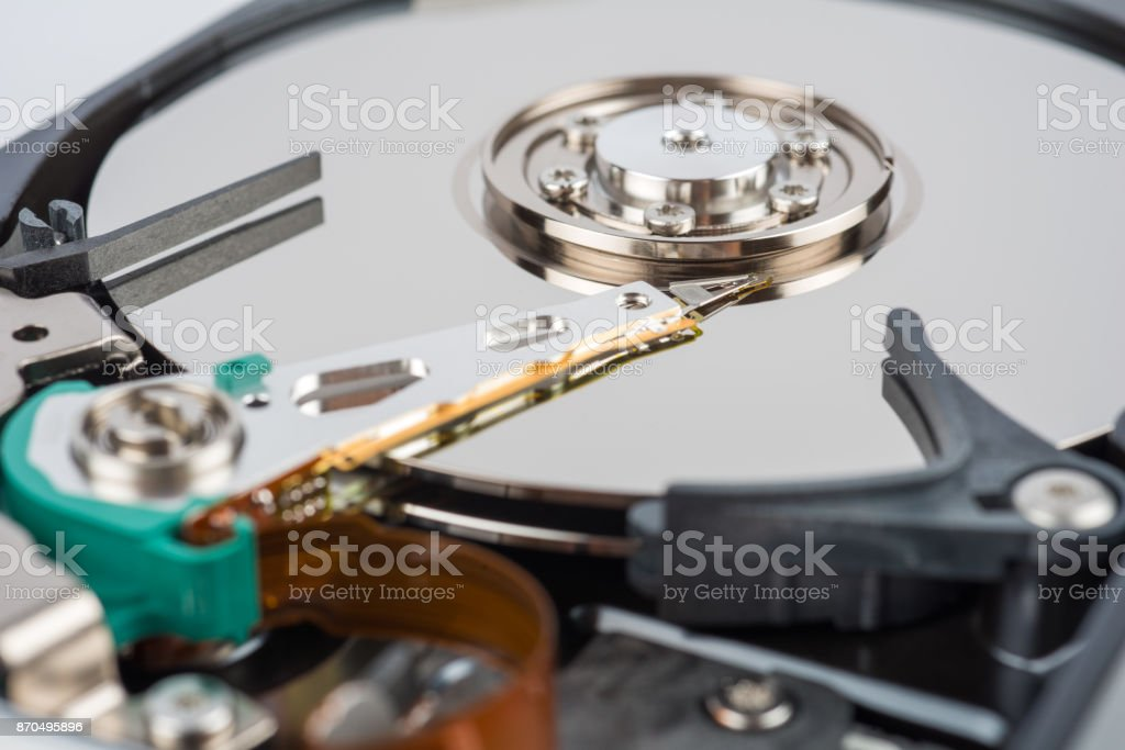 Hard drive disk - detail with reading arm stock photo