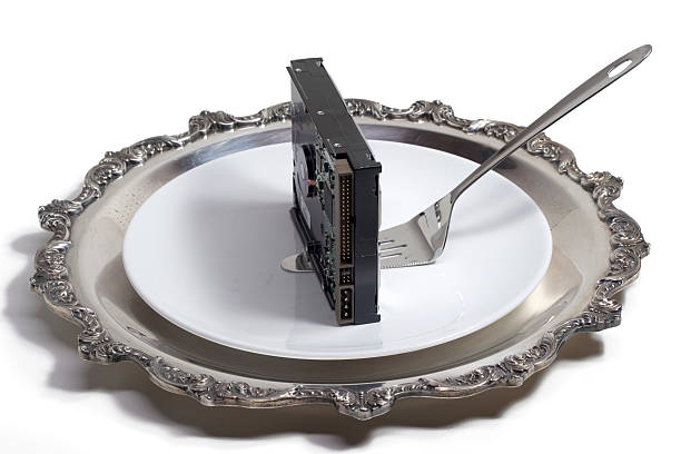 Hard drive served on a plate (isolated, clipping path) stock photo