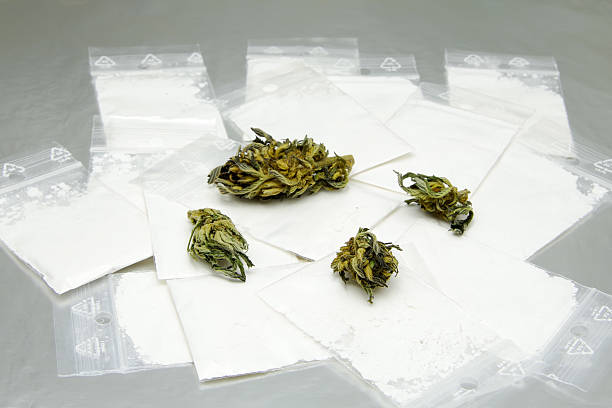 Hard drugs and marijuana stock photo