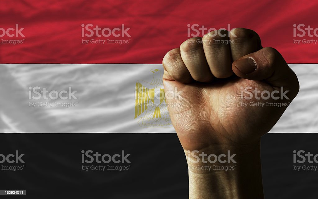 Hard fist in front of egypt flag symbolizing power royalty-free stock photo