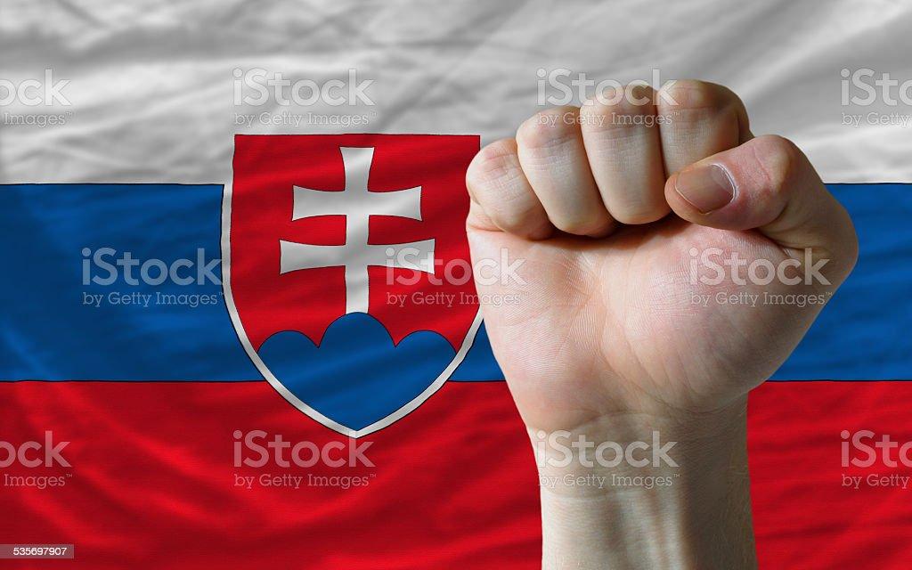 Hard fist in front of slovakia flag symbolizing power stock photo