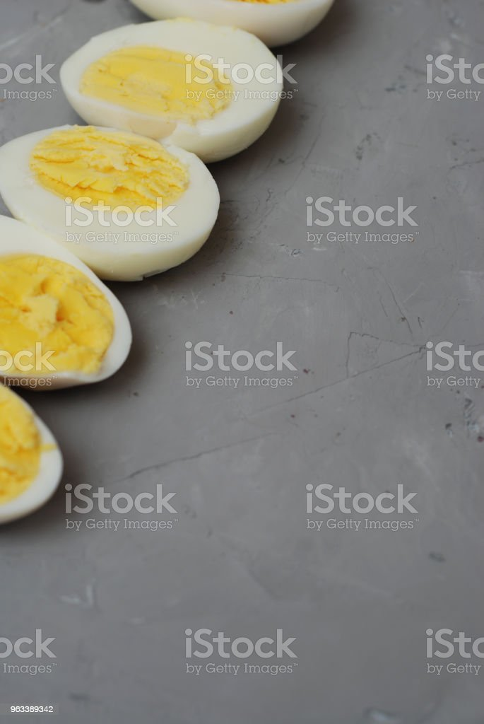 Hard Half Boiled Eggs, Sliced in Halves Food Ingredient Preparation Gray Textured Background - Zbiór zdjęć royalty-free (Białko)