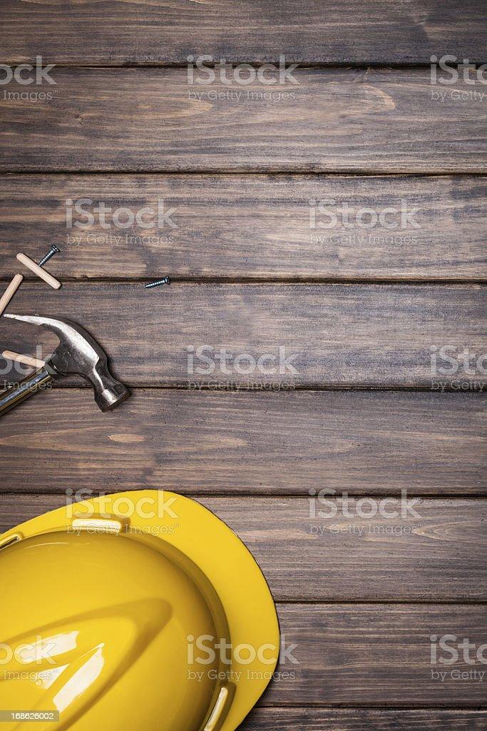 hard hat on wooden background stock photo