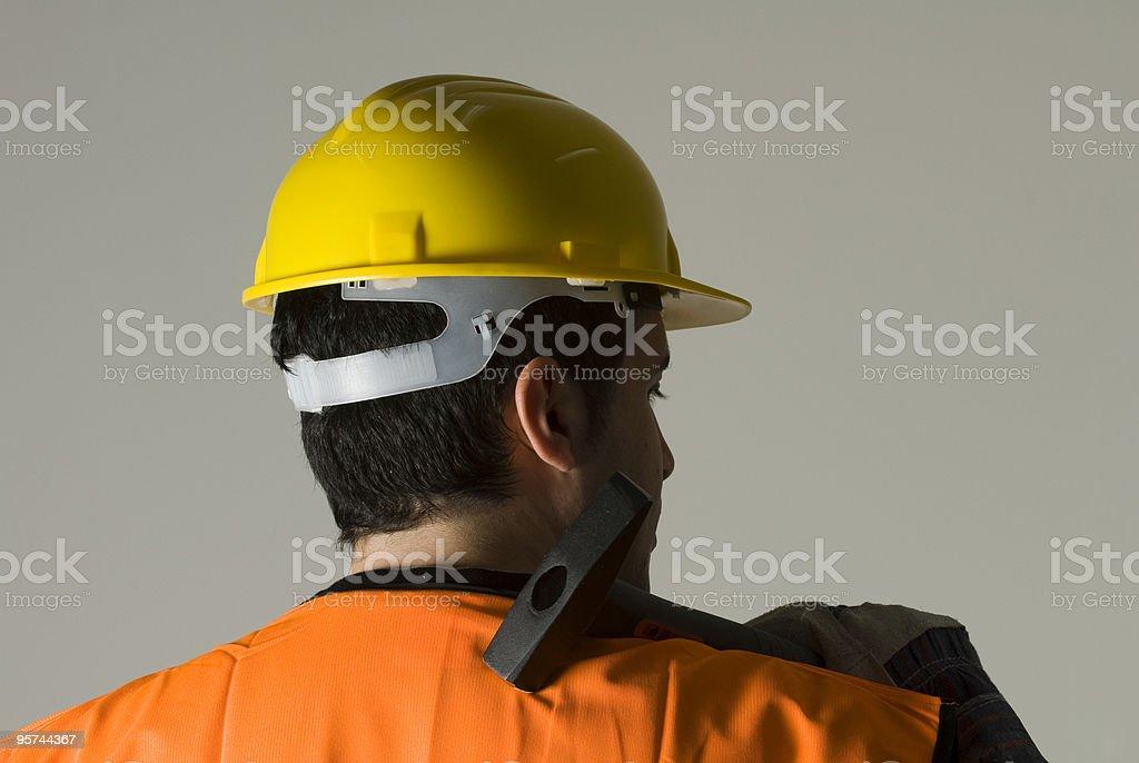 Hard Hat Worker holding hammer, Istanbul, Turkey royalty-free stock photo