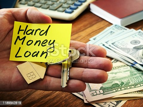Hard money loan sign and key from home.