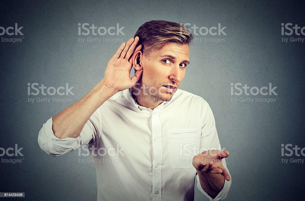 hard of hearing man asking someone to speak up stock photo