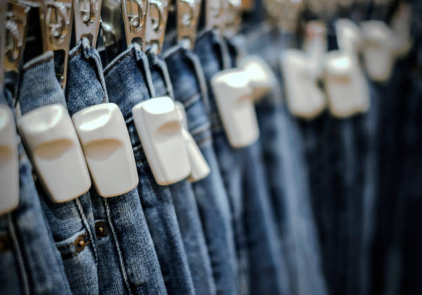 RFID hard tag on blue jeans pants in shop RFID hard tag on blue jeans pants in shop radio frequency identification stock pictures, royalty-free photos & images