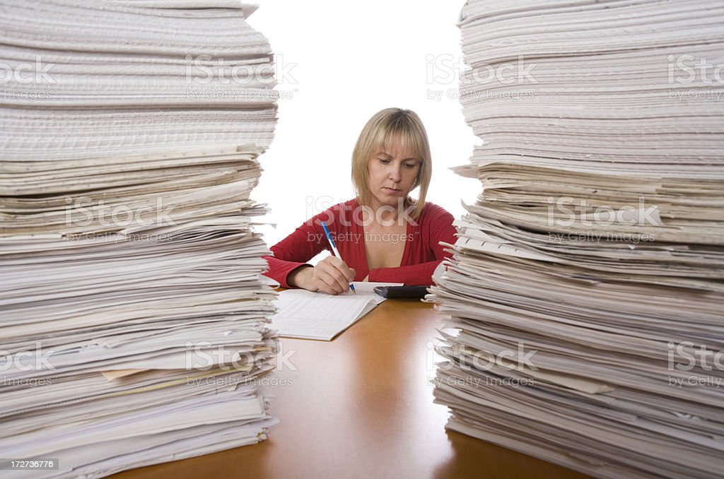 Hard worker and stack of papers royalty-free stock photo