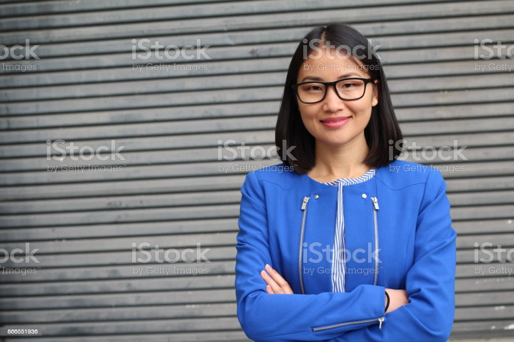 Hard worker looking businesswoman with arms crossed stock photo