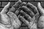 Hard working dirty hands in a black and white shot