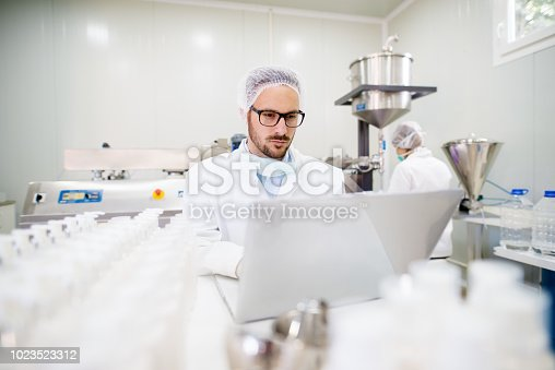 Hard working lab employee working on a computer.