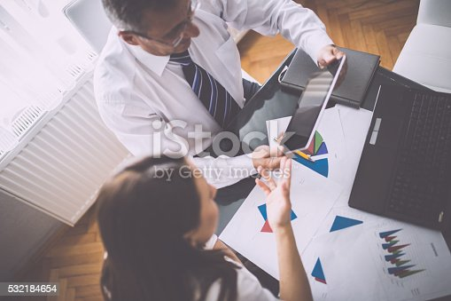 672116416istockphoto Hard working office 532184654