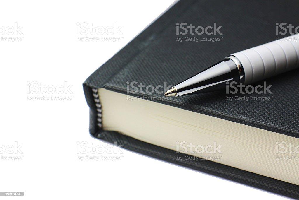 Hardback book and pen stock photo